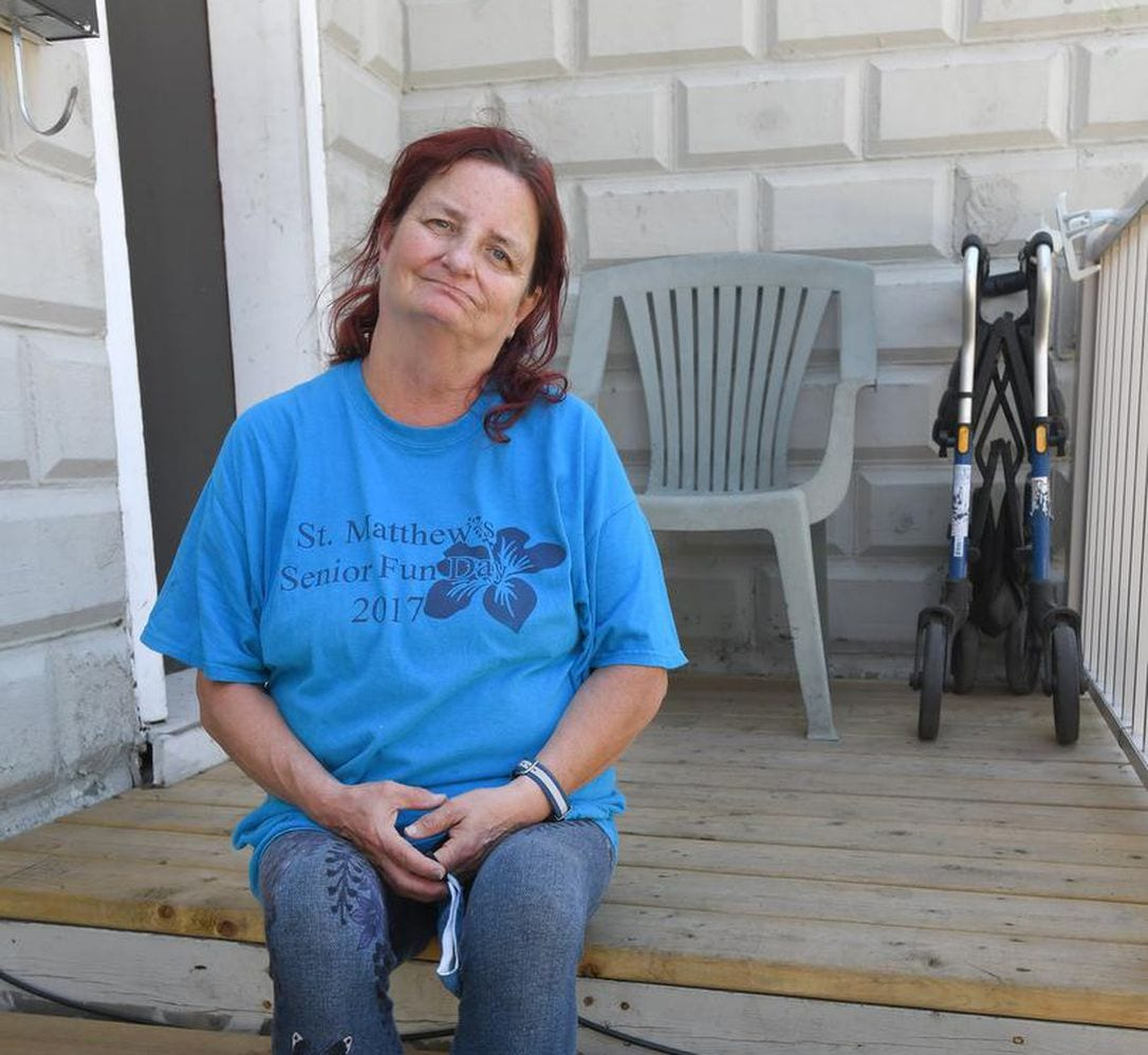 Jackie Potter sits on her porch
